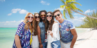 Happy hippie friends with selfie stick on beach Royalty Free Stock Photos