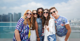 Happy hippie friends with selfie stick over city Royalty Free Stock Images