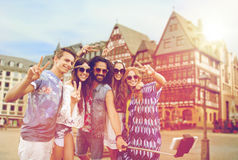Happy hippie friends taking selfie in frankfurt. Travel, tourism and people concept - smiling young hippie friends in sunglasses taking picture by smartphone royalty free stock photos