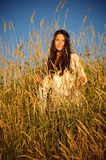 Happy hippie girl. Beautiful hippie girl stands in the grass smiling Stock Photography