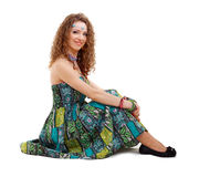 Happy hippie girl sitting on the ground Stock Photography