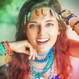 Happy hippie. Portrait of pretty hippie girl wearing handmade jewelery stock photography