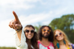 Happy hippie woman pointing finger outdoors Stock Photo