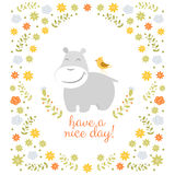 Happy hippo on floral background Stock Images
