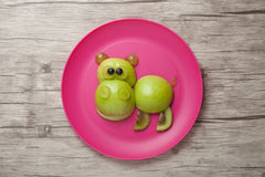 Happy hippo made of fruits Stock Image