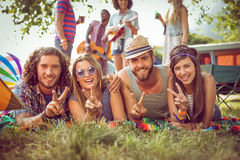 Happy hipster couples on campsite. At a music festival Stock Image