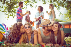 Happy hipster couples on campsite. At a music festival royalty free stock images