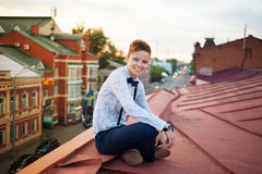 Happy hipster on the edge of the roof Royalty Free Stock Image