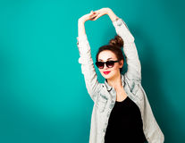 Happy Hipster Fashion Girl on Turquoise Background Stock Image