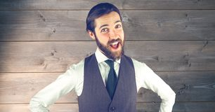 Happy hipster in formals against wooden wall Stock Photos