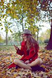 Happy hipster girl with cell phone Royalty Free Stock Photo