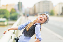 Happy hipster girl on city street Stock Image
