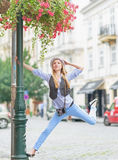 Happy hipster girl having fun on city street Royalty Free Stock Photography