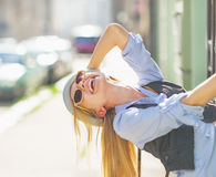 Happy hipster girl having fun on city street Stock Image