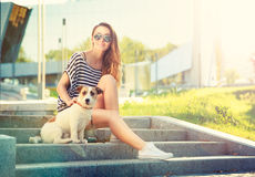 Happy Hipster Girl with her Dog in the City Stock Photo