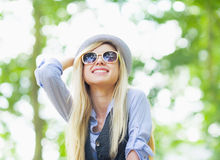 Happy hipster girl rejoicing in the park Royalty Free Stock Photo