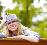 Hipster girl rejoicing in the park Stock Photography