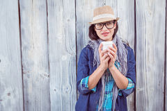 Happy hipster holding a cup in her hand Stock Photos
