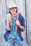 Happy hipster holding a cup in her hand Royalty Free Stock Images
