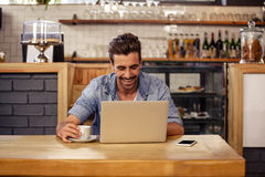 Happy hipster man using tablet and drinking coffee Stock Image