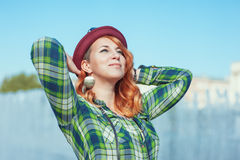 Happy hipster redhead girl in checkered shirt Stock Image