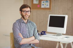Happy hipster sitting at his desk Royalty Free Stock Photography