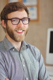 Happy hipster sitting at his desk Royalty Free Stock Image