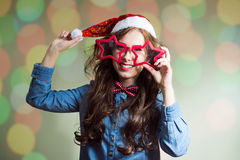 Happy hipster in supersize star shaped glasses and Royalty Free Stock Photography