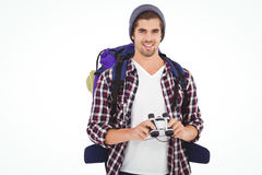 Happy hipster wearing backpack holding binoculars Stock Images