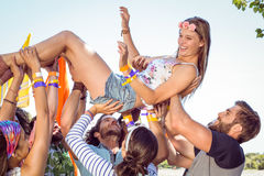Happy hipster woman crowd surfing Royalty Free Stock Photo
