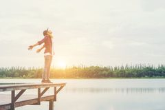 Happy hipster woman enjoying leisure at the pier lake,relaxing e. Njoy with natural Royalty Free Stock Images