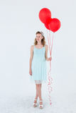 Happy hipster woman holding balloons. On white background Royalty Free Stock Photo