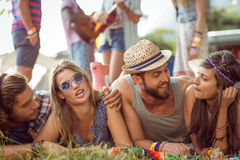 Happy hipsters chatting on the campsite royalty free stock photography
