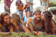 Happy hipsters chatting on the campsite Royalty Free Stock Photos