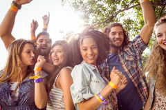 Happy hipsters dancing to the music stock photography