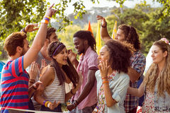 Happy hipsters dancing to the music stock images