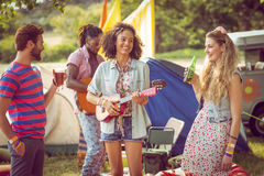 Happy hipsters having fun on campsite. At a music festival stock images