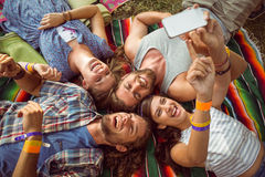 Happy hipsters lying on the grass Royalty Free Stock Image