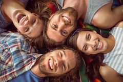 Happy hipsters lying on the grass royalty free stock photos