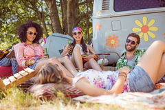 Happy hipsters relaxing on the campsite Royalty Free Stock Images