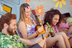 Happy hipsters relaxing on campsite Stock Photography