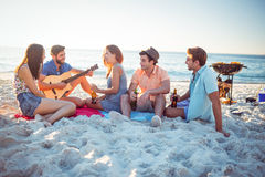 Happy hipsters relaxing and playing guitar Royalty Free Stock Image