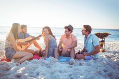 Happy hipsters relaxing and playing guitar Stock Images