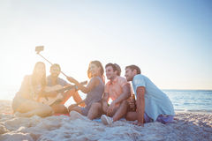 Happy hipsters taking pictures with selfie stick Stock Photo
