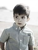 Happy hispanic boy with curious expression Royalty Free Stock Photo