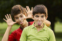Happy hispanic boys making a grimace at camera Stock Photos