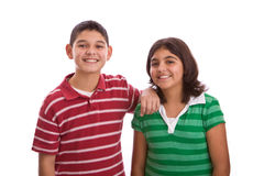 Happy Hispanic brother and sister isolated on white. Portrait of a Hispanic brother and sister royalty free stock photography