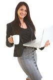 Happy hispanic business female on laptop Royalty Free Stock Photos