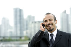 Happy Hispanic Businessman on phone Royalty Free Stock Photo
