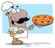 Happy hispanic chef carrying a pizza pie Royalty Free Stock Photography